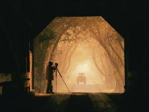 A Photographer Sets up His Camera in a Covered Bridge by Richard Nowitz