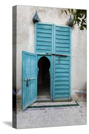 An Arched Door in Le Jardin Des Biehn, a Riad or Small Hotel in the Medina of Fez