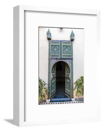 An Arched Painted Door in Le Jardin Des Biehn, a Riad or Small Hotel in the Medina of Fez