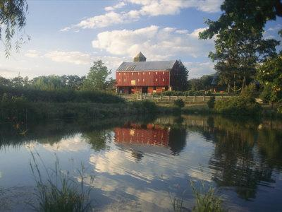 An Old Red Barn Reflected in a Pond
