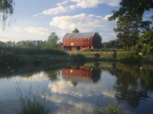 An Old Red Barn Reflected in a Pond by Richard Nowitz