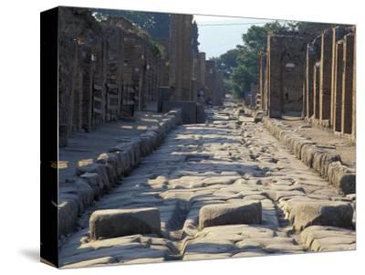 Ancient Roman Street with Chariot Ruts and Stepping Stones in Pompeii, Italy