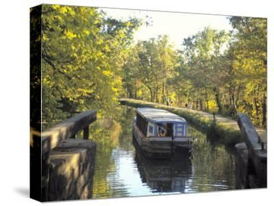 C and O Canal and Towpath with Barge and Hikers