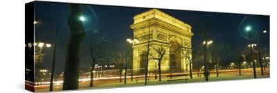 Night View of the Illuminated Arc De Triomphe in Paris