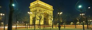 Night View of the Illuminated Arc De Triomphe in Paris by Richard Nowitz