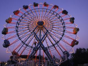 People Ride an Upsidedown Ferris Wheel in Wildwood, New Jersey by Richard Nowitz