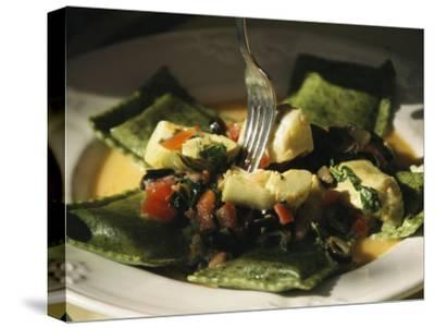 Plate of Ravioli with Artichokes and Tomatoes