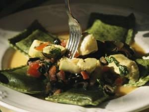 Plate of Ravioli with Artichokes and Tomatoes by Richard Nowitz