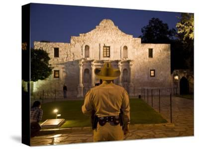 Rear View of a Texas Ranger Standing in Front of the Alamo at Twilight