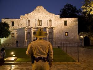 Rear View of a Texas Ranger Standing in Front of the Alamo at Twilight by Richard Nowitz