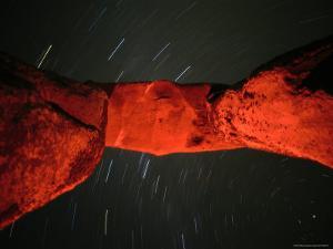 Star Streaks Above the Stone Monoliths of Stonehenge by Richard Nowitz