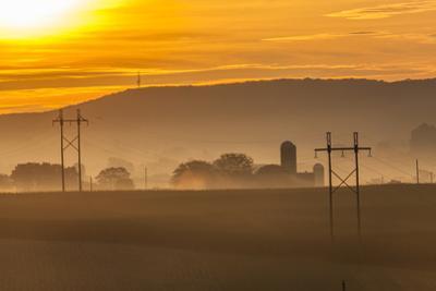 Sunrise and Fog over a Farm Along Pennsylvania Route 23 East of Lancaster, Pennsylvania by Richard Nowitz
