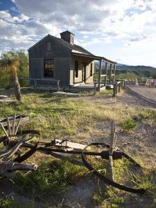 Texas, Western Themed Brewster County. Ruins of Farm Equipment and Wooden Cabin by Richard Nowitz