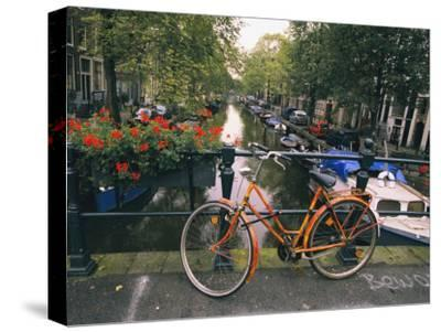 The Keizersgracht Canal, with Potted Flowers and a Bicycle in the Foreground
