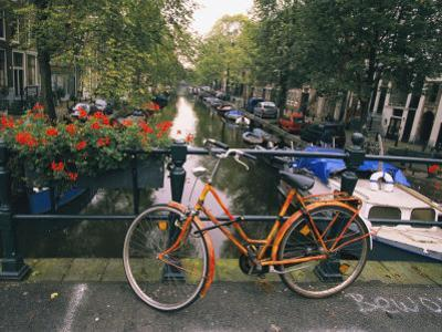 The Keizersgracht Canal, with Potted Flowers and a Bicycle in the Foreground by Richard Nowitz