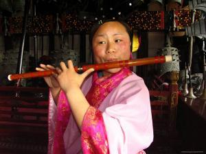 The Musician is Playing a Chinese Flute at the Temple of Eternal by Richard Nowitz