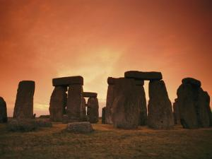 The Setting Sun Casts an Eerie Glow over Stonehenge by Richard Nowitz