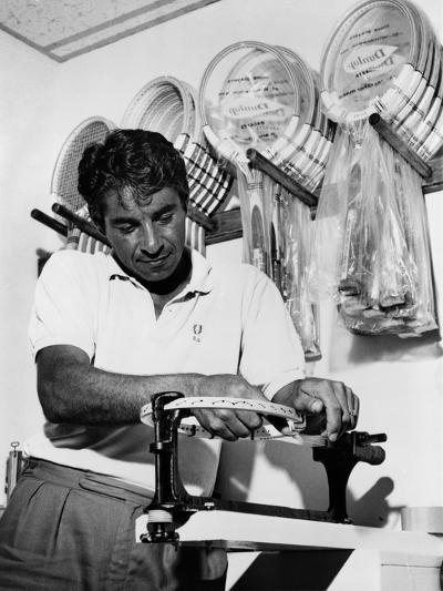 Richard 'Pancho' Gonzales Restringing a Tennis Racket in 1962--Photo