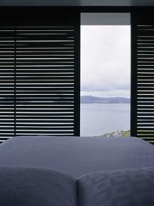 Bedroom with a View in Shark Alley House, Great Barrier Island, New Zealand by Richard Powers