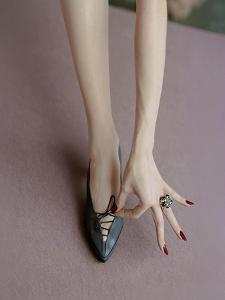 Vogue - April 1957 - Manicured Hand & Lace-up Shoes by Richard Rutledge