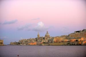 Valletta, Malta, Waterfront City Skyline During Sunset by Richard Wright