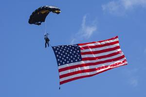 USA, Oregon, Hillsboro, Skydiver with is parachute deployed by Rick A Brown