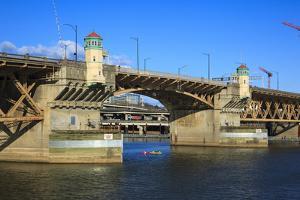 USA, Oregon, Portland, Kayakers Paddling under the Burnside Bridge by Rick A Brown