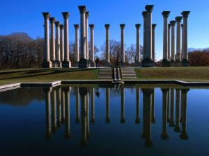 Capitol Columns Reflected in a Pool in the Gardens of US National Arboretum, Washington Dc, USA by Rick Gerharter