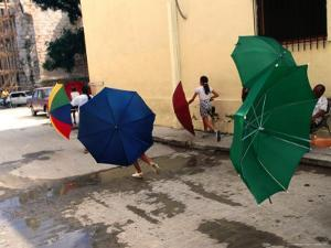 Girls with Umbrellas in Street of Old Havana, Havana, Cuba by Rick Gerharter