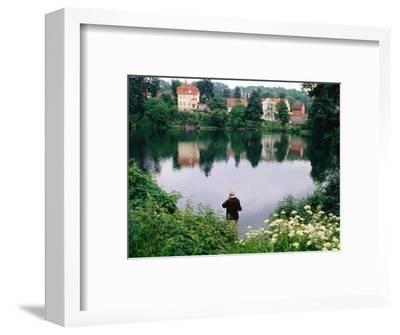 Man Fishing in Lake in In Oliwa, Gdansk, Poland