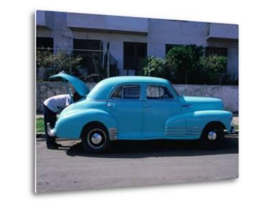 Man Looking in Boot of a Blue 1948 Chevrolet, Vedado, Cuba