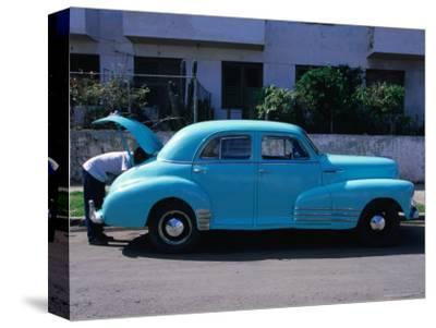 Man Looking in Boot of a Blue 1948 Chevrolet, Vedado, Cuba