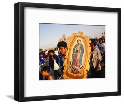 Pilgrim Carrying Icon of Virgin Mary at the Basilica De Guadalupe, Mexico City, Mexico