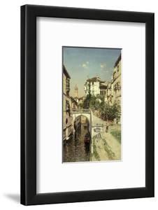 A Venetian Canal Scene by Rico y Ortega Martin