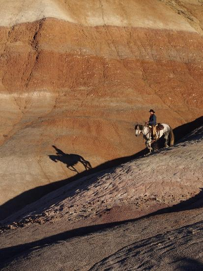 Rider with Shadow Coming down Hill in Painted Desert-Terry Eggers-Photographic Print