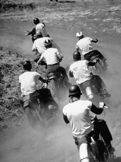 Riders Enjoying Motorcycle Racing, Leaving a Trail of Dust Behind-Loomis Dean-Photographic Print