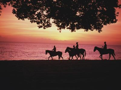 Riding Horses on the Beach at Sunset-Design Pics Inc-Photographic Print