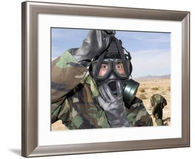 Rifleman Puts on His Gas Mask-Stocktrek Images-Framed Photographic Print