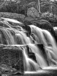 Water Flowing Over Rocks on a Waterfall by Rip Smith