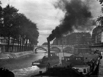 River Boat Smoke Passes along the River Seine-Andreas Feininger-Photographic Print