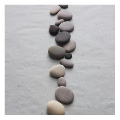 River Stones on Sand