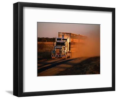 Road Train Driving along Dusty Road, Kynuna, Australia-Holger Leue-Framed Photographic Print
