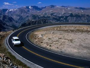 Car on Windy Road Near Beartooth Pass Beartooth Wilderness, Montana, USA by Rob Blakers