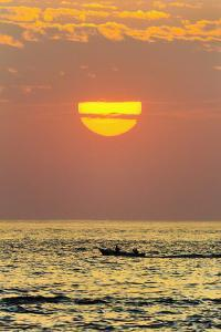 Fishing Boat and Sunset Off Playa Guiones Surf Beach by Rob Francis