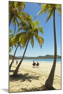 Horse Riders on Beautiful Palm Fringed Playa Carrillo by Rob Francis