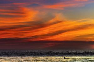 Lone Surfer and Sunset Clouds Off Playa Hermosa Surf Beach, Santa Teresa, Costa Rica by Rob Francis