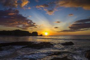 Sunset by the Southern Headland of Beautiful Playa Pelada Beach by Rob Francis