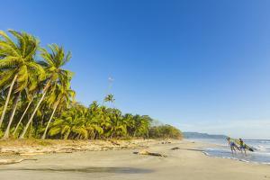 Surfers on Playa Santa Teresa, Puntarenas by Rob Francis