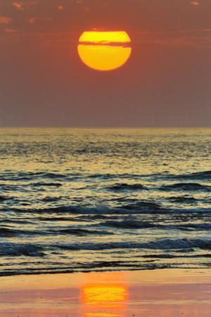 The Sun Setting Off Playa Guiones Surf Beach by Rob Francis