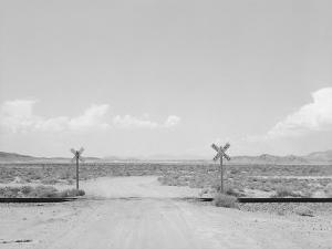 Black and White Image of a Train Cross by Rob Lang